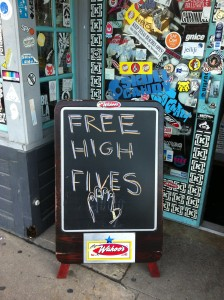 """Sandwich board out front of Wahoo's Fish Tacos says """"Free High Fives"""""""